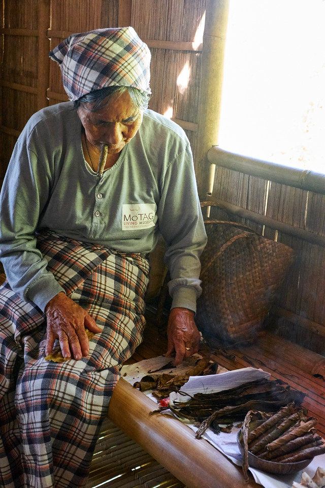 They grow tobacco and sell what they don't use. This woman is rolling cigars.