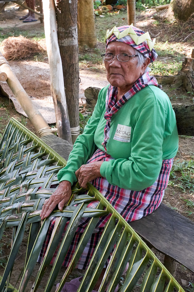 Weaving palm leaves for roofing.