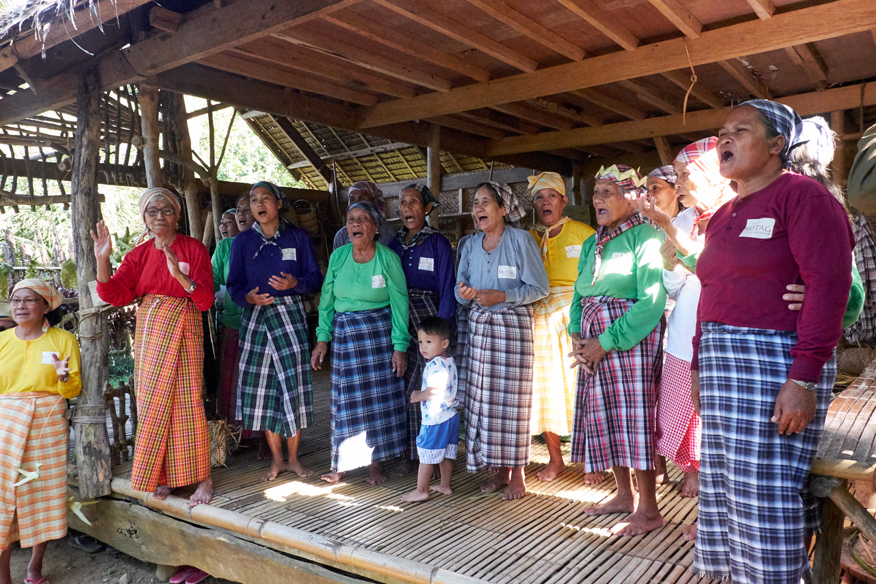 Women at the museum sing a traditional song.