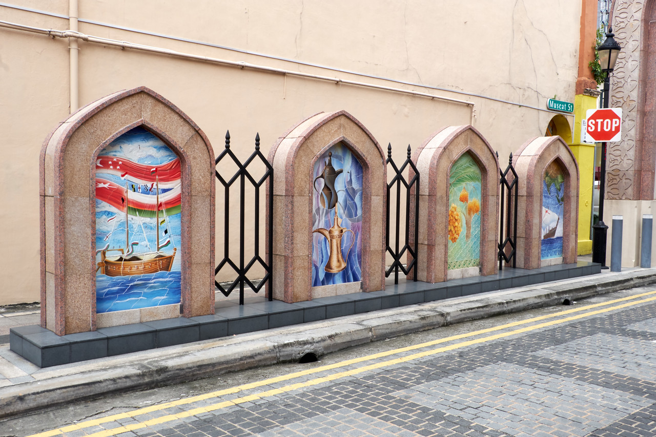 Art work decorating Muscat Street at one of the entrances to the Sultan's Mosque.
