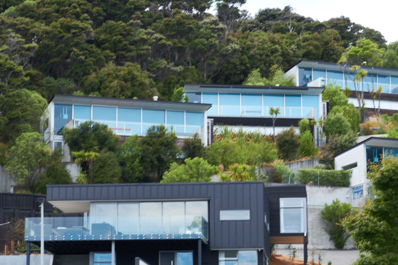 Modern homes built on the hillside overlooking the bay.