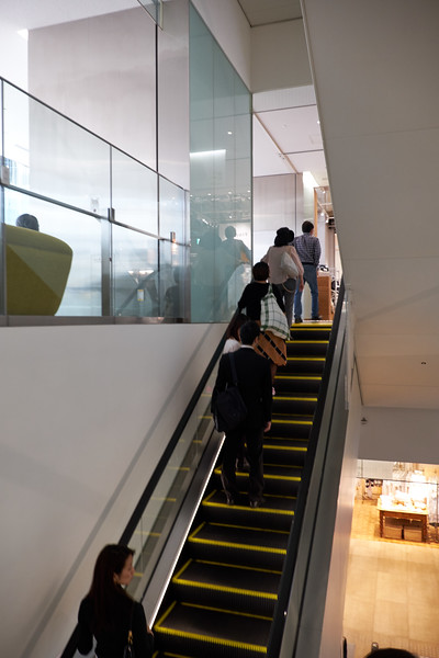 Japanese always ride the escalator to the left side leaving the right side for others to go ahead of them.