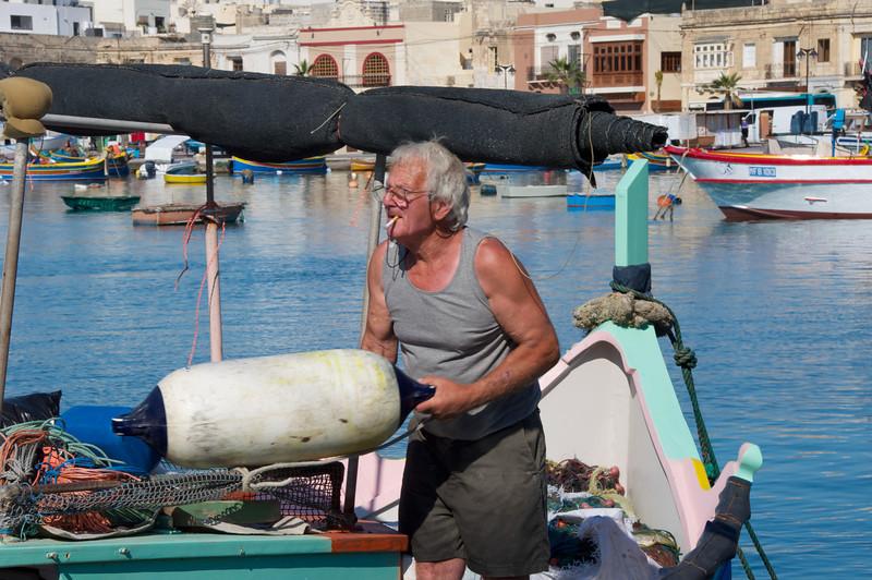Local in Marsaxlokk Dropping Anchor