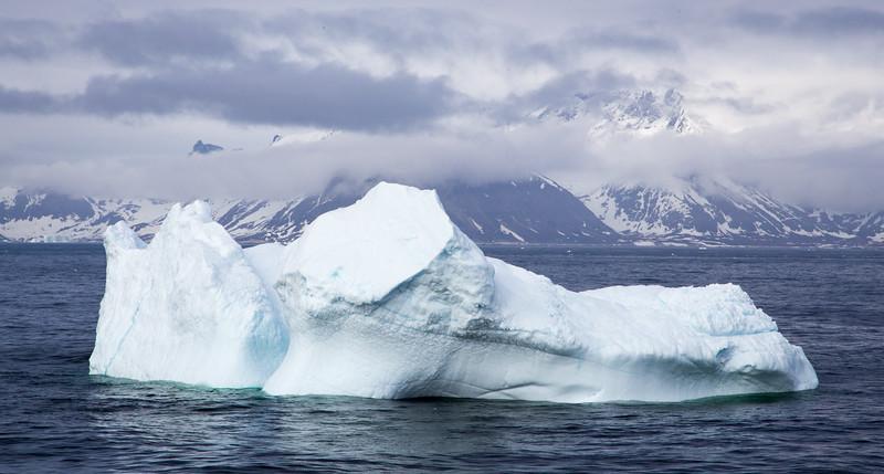 Iceberg in open sea; ship heading to Nuuk