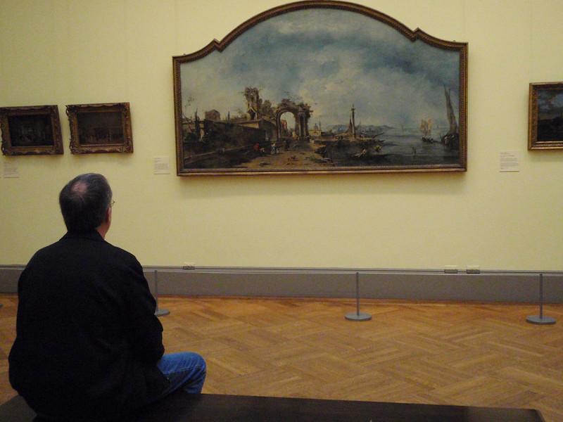 """Kenny admires Francesco Guardi's """"Fantastic Landscape"""" ca 1760."""