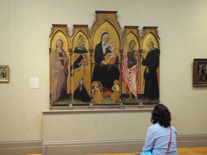 "Sheila admiring Giovanni de Paolo's ""Madonna and Child with Saint"" alterpiece from 1454."