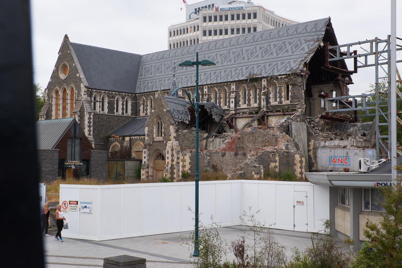 Christchurch Cathedral. It has been sitting like this for 5 years. The church wants to demolish it and rebuild. The townspeople want to restore it (from bus).