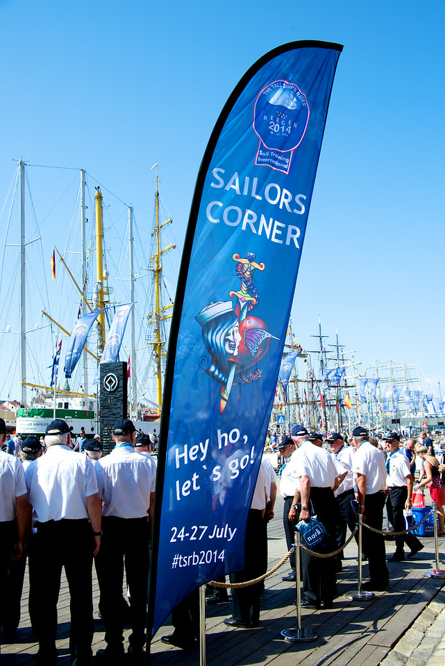 The men singing, Tall Ships and the Festival flag