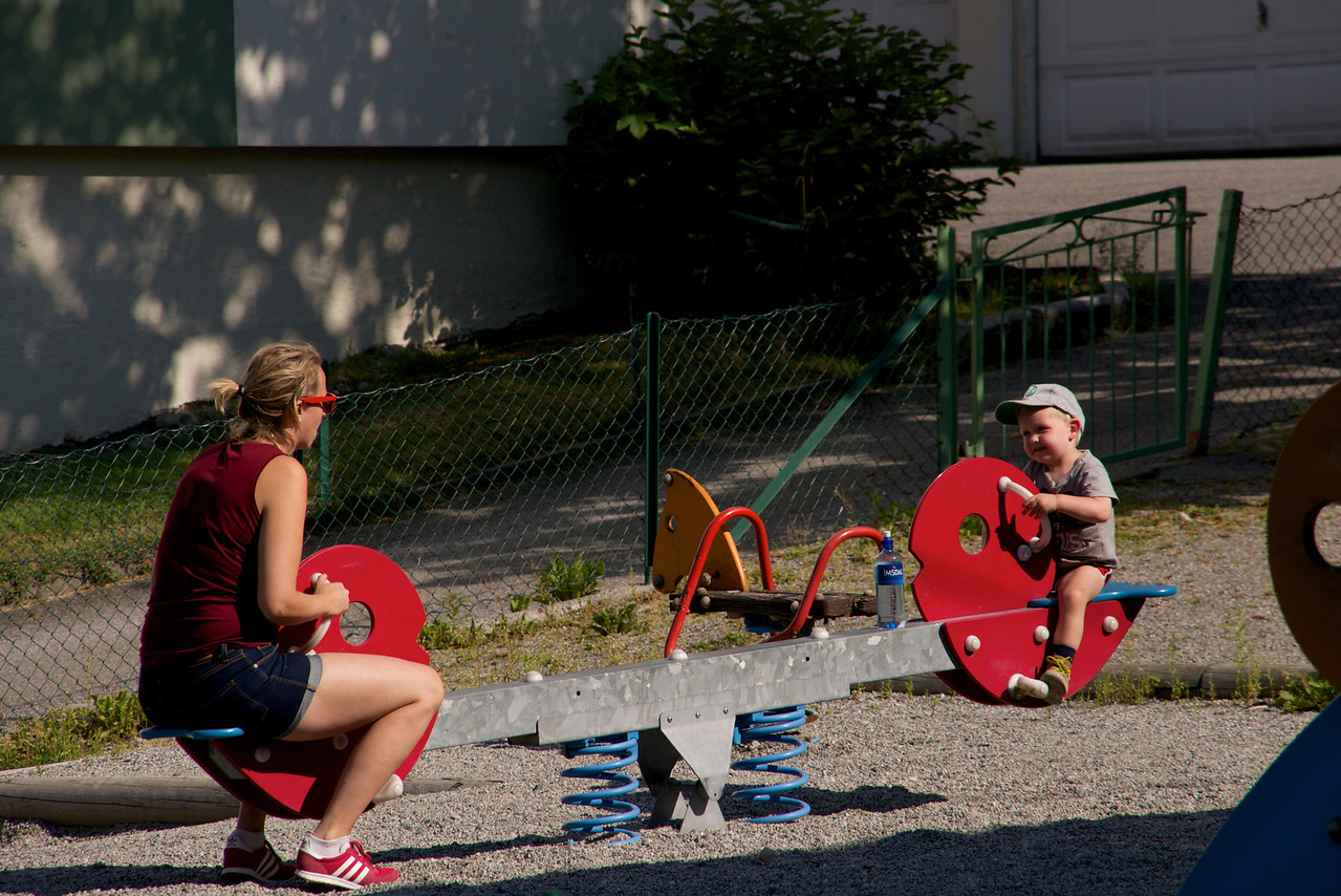Mother and son playing on the apartment playground