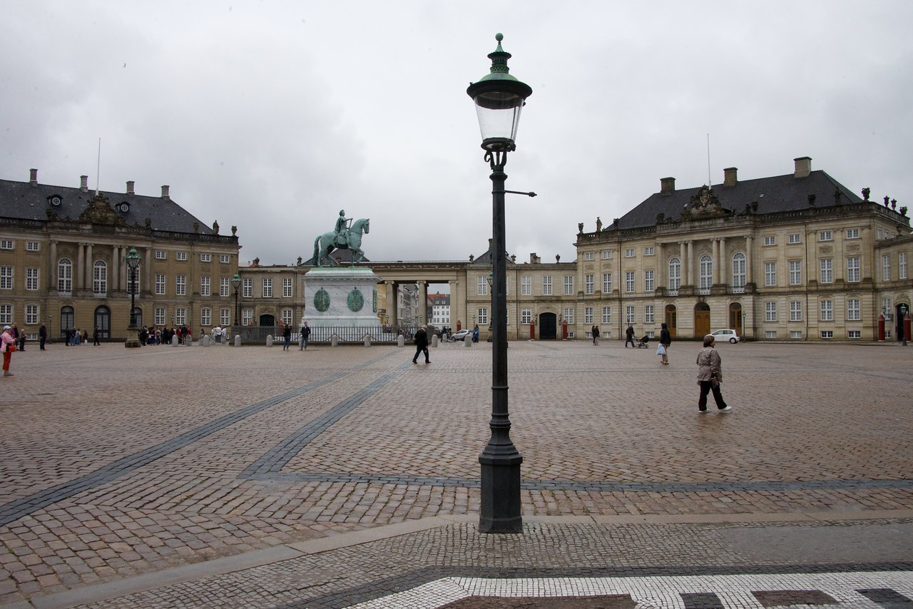 Amalienborg consists of four identical classicizing palace façades with rococo interiors around an octagonal courtyard  In the centre of the square is a monumental equestrian statue of Amalienborg's founder, King Frederick V