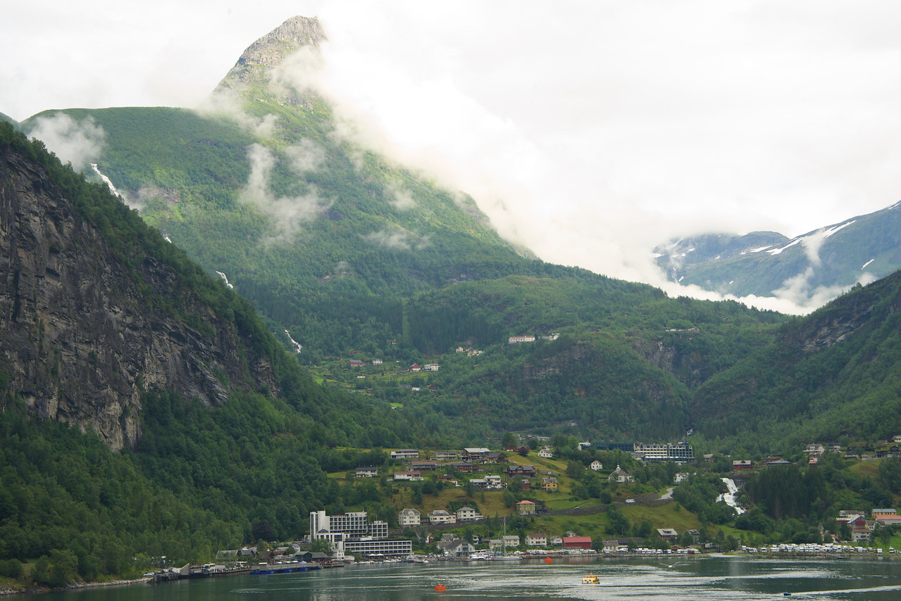 Dalsnibba point peaking through the clouds    Geiranger below