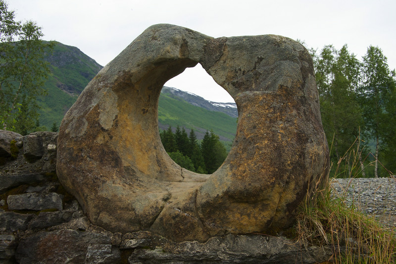 This rock is known as Giftessteinem. The hole in the rock is a natural formation. The local myth is that brides pass thru the hole and if they don't make it, they are pregnant.