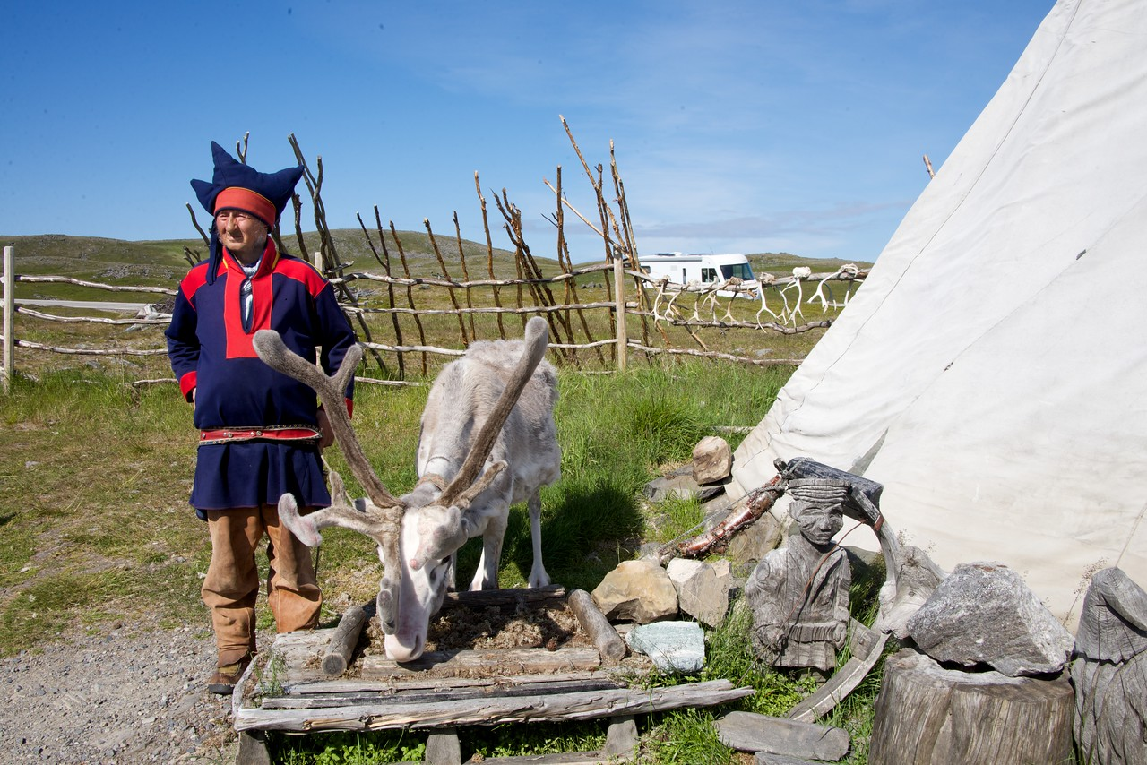 Sami Man with His Reindeer Standing by His Tepee