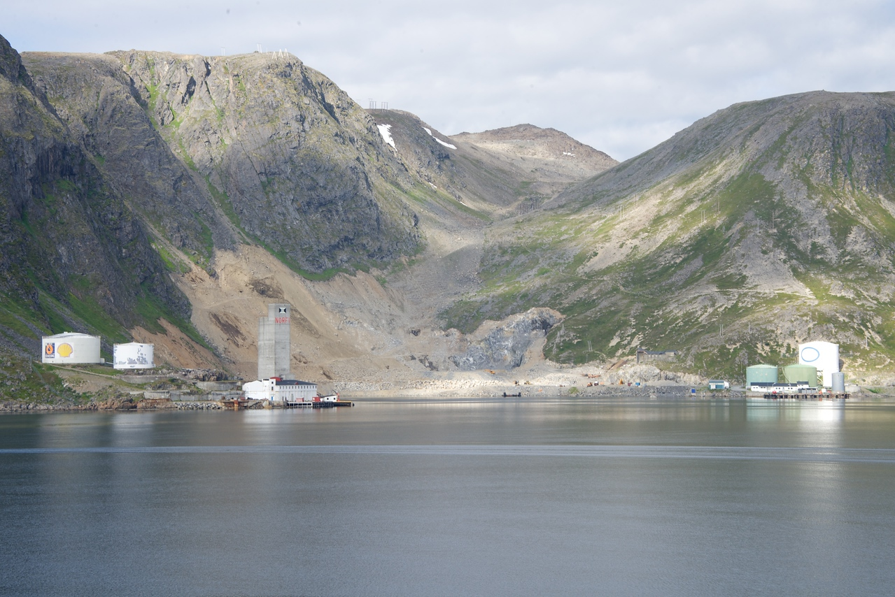 Industry Immediately Across Fjord from Ship