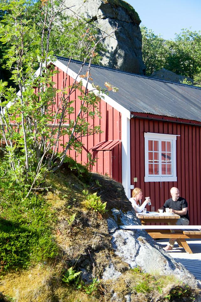 Tourist having breakfast outside their fish house