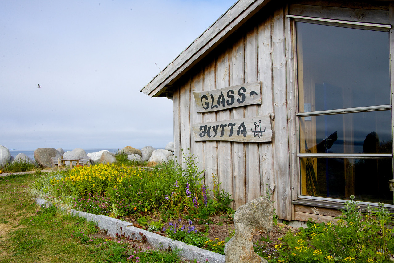 In the middle of Lofoten, between steep mountains, and facing the harsh windy coast, is Vikten village. This is where the Glass Hut is located (Handblown glass).