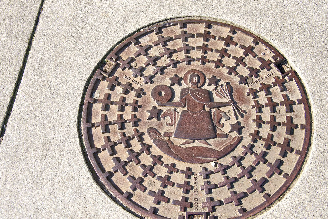 Sewer cover depicts legend of the founding of the city