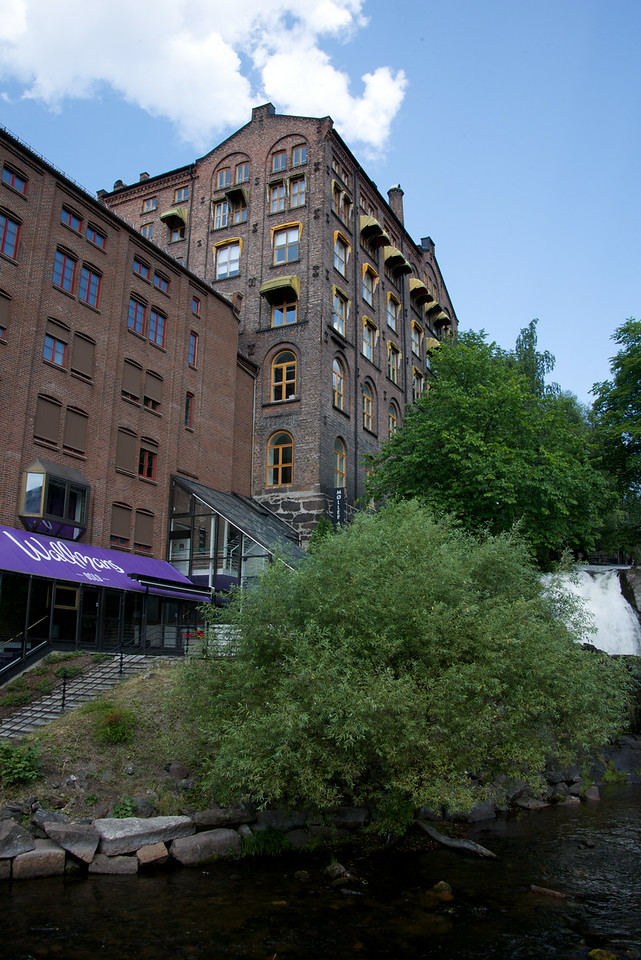 Old manufacturing building that has been turned into apartments with restaurants and clubs on the bottom food