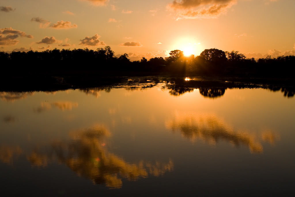 The rising sun bathes the landscape in a golden glow.
