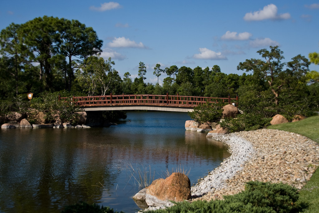 View of the James and Hazel Gates Woodruff Memorial Bridge from the visitor's center.  The bridge, which marks the entrance to the gardens, was built to honor Mrs Woodruff, a lover of Japanese gardens, and her husband, a US Naval commander and veteran of Pearl Harbor.  The bridge symbolizes the link between Japan and Florida.