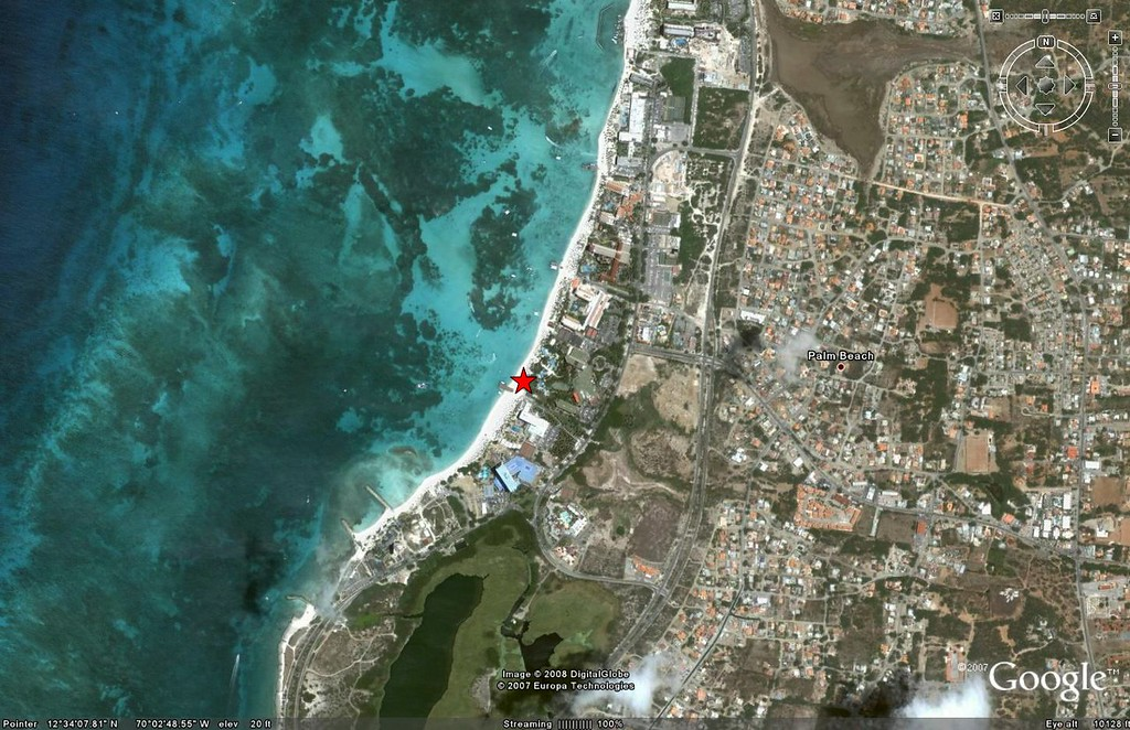 And this satellite view from Google Earth shows where on Palm Beach we spent our morning.  (The little jetty next to the star is De Palm Pier - we were just to the right of the pier.)