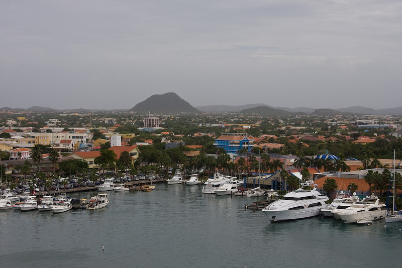 The marina downtown with Hooiberg in the distance.