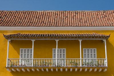 Detail from the Casa del Premio Real.  The use of terra cotta tiles atop the roofs of wooden balconies is typical of Andalusian architecture.