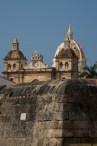 A glimpse of Iglesia de San Pedro Claver behind the coral fortifications that surround the old city.