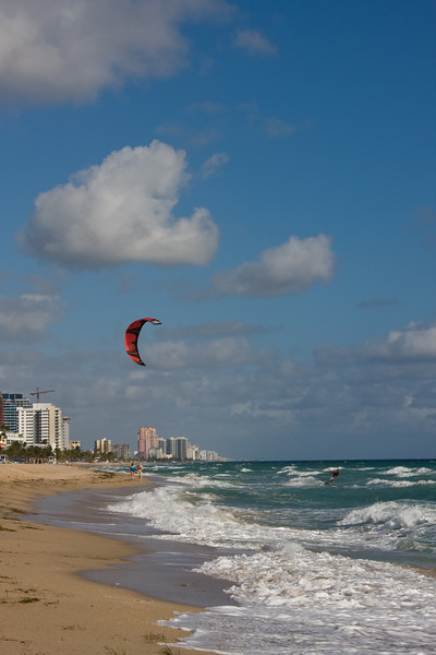 Fort Lauderdale Beach, Florida:<br /> Windsurfer enjoying the wind and surf on a quiet morning on the beach.