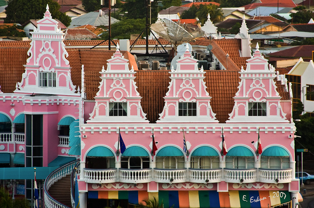 Oranjestad, Aruba:<br /> I just love the architecture and the bright colors; all that white trim reminds me of a wedding cake.