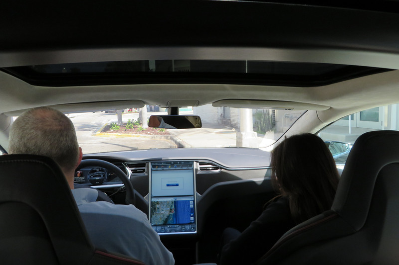 The Tesla gal rode shotgun so she could point out all the features of the car to Ted.