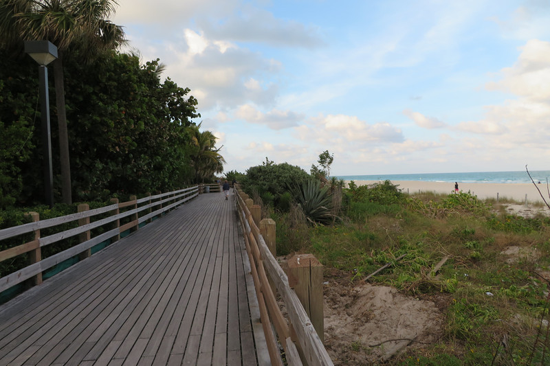 There is a nice boardwalk next to the beach.