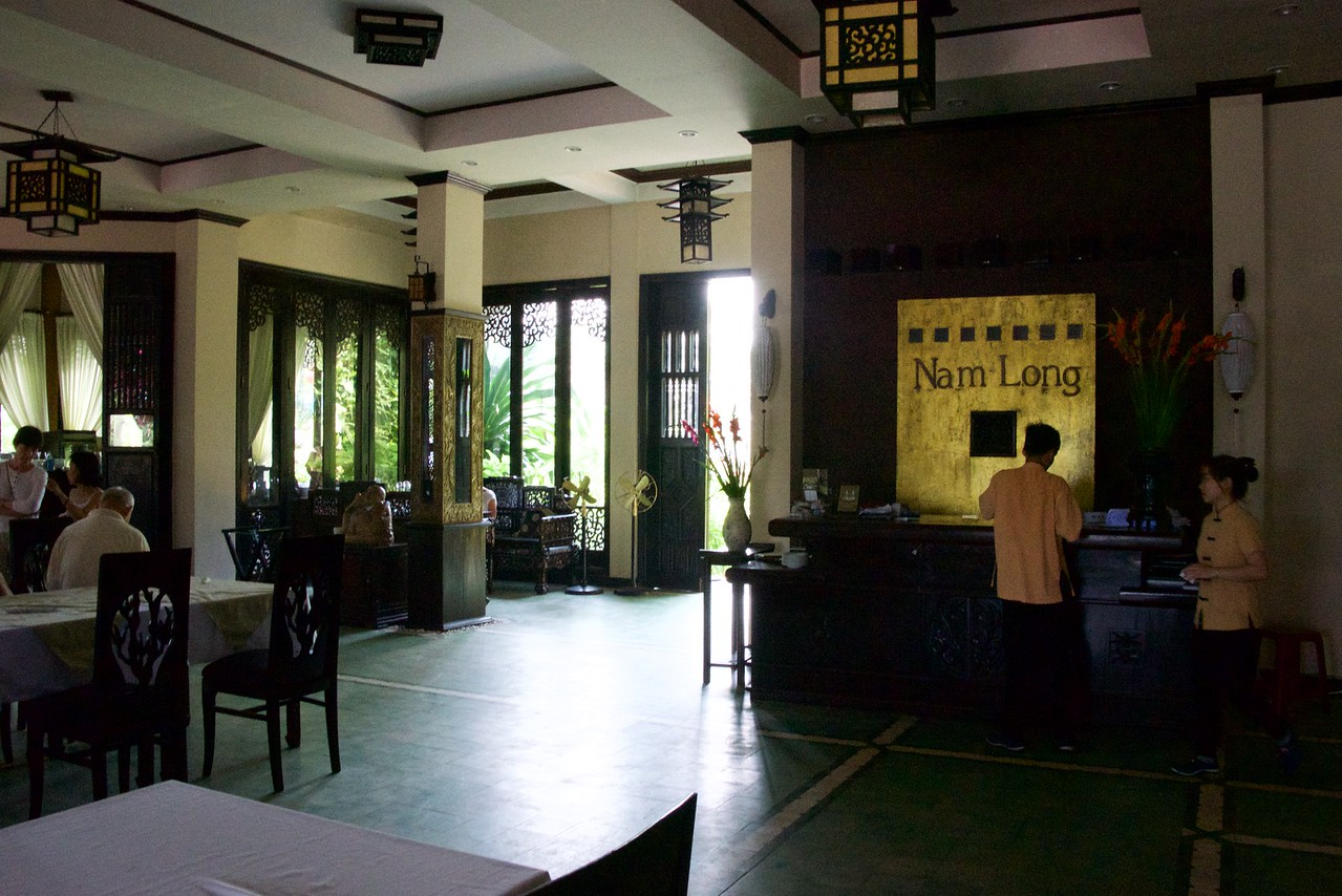 The decoration is a mixture of colonial style and traditional Vietnamese.