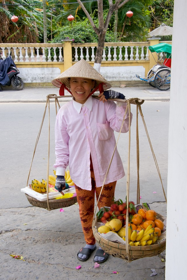 She wanted me to take her picture after I took the previous fruit vendor.