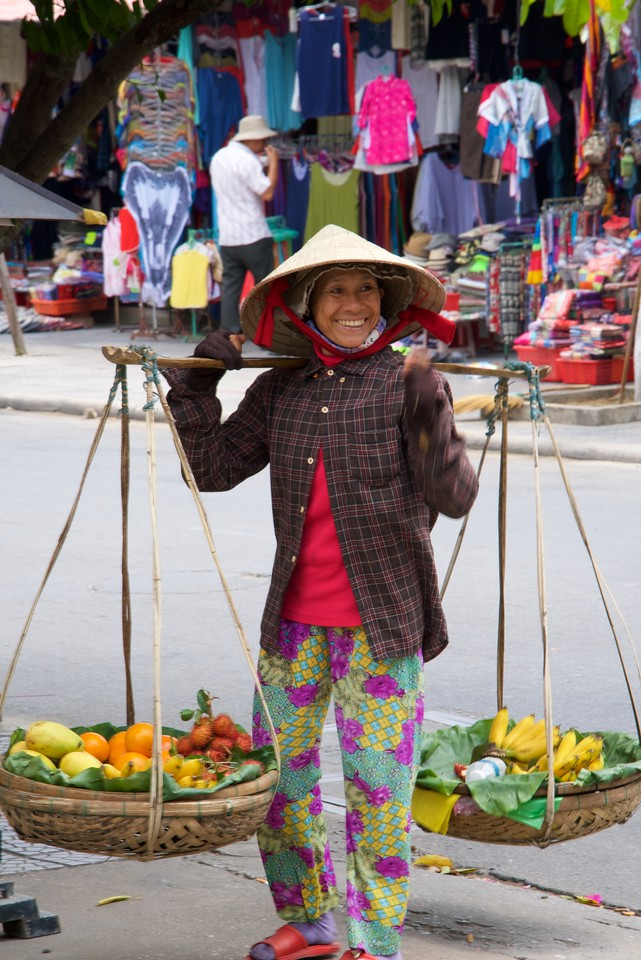 Vietnamese woman selling fruit on the streets of Hoi An.