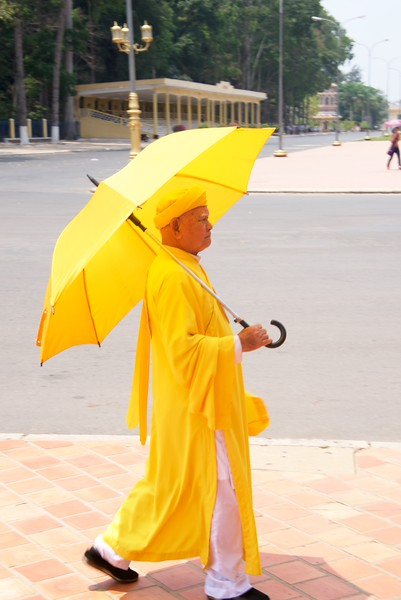 The three principal colors of Cao Dai are yellow (for Buddhism), blue (for Taoism), and red (for Christianity), and these appear in worshippers' robes as well as the temple.
