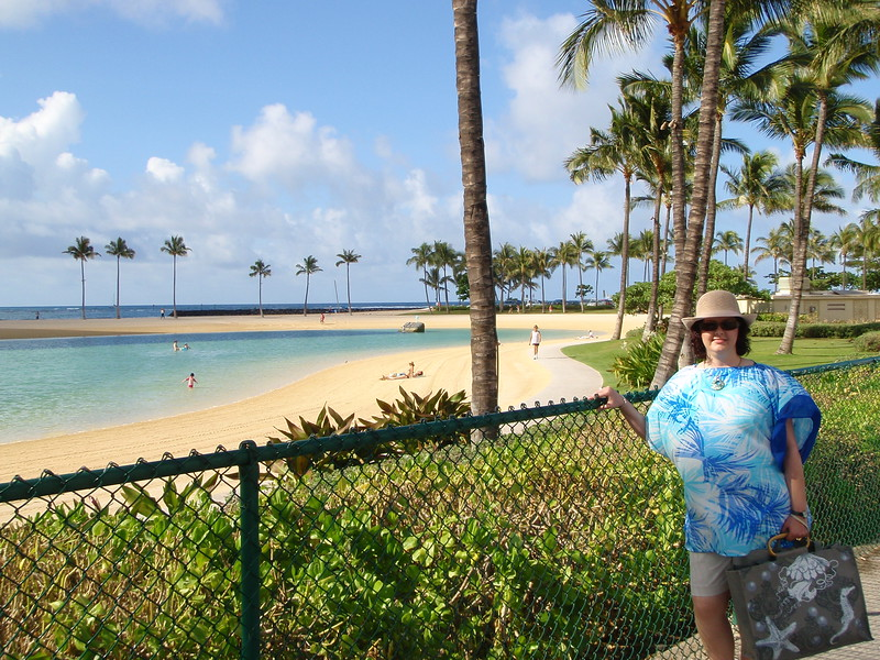 Sheila poses near the Duke Kahanamoku Lagoon at the resort.