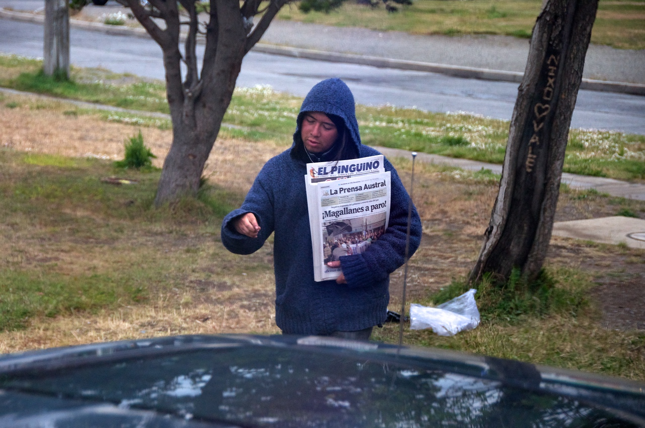 Local Selling Papers on Street Corner2011-01-1111-37-21