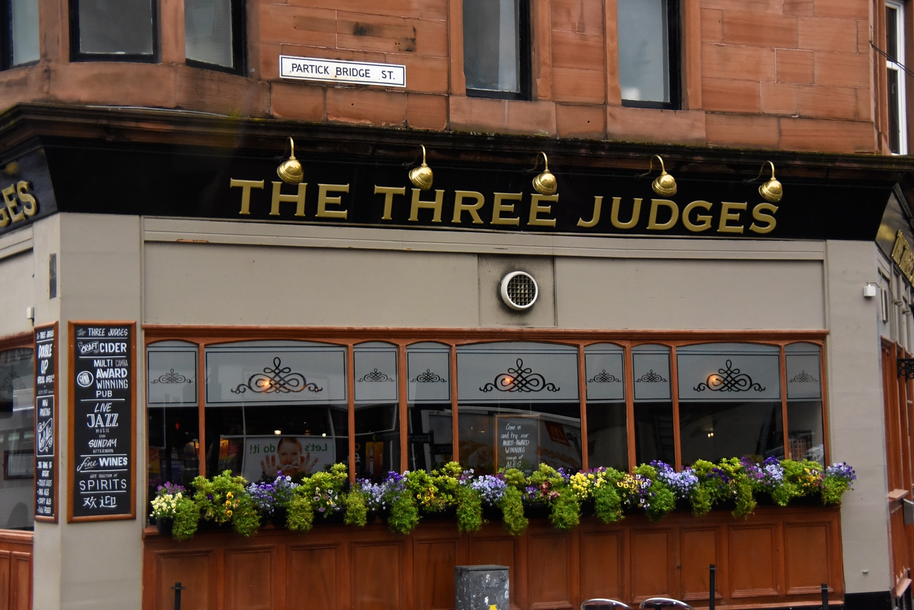 The Three Judges Pub Refers To The Three Judges In A Boxing Match  (From Bus)