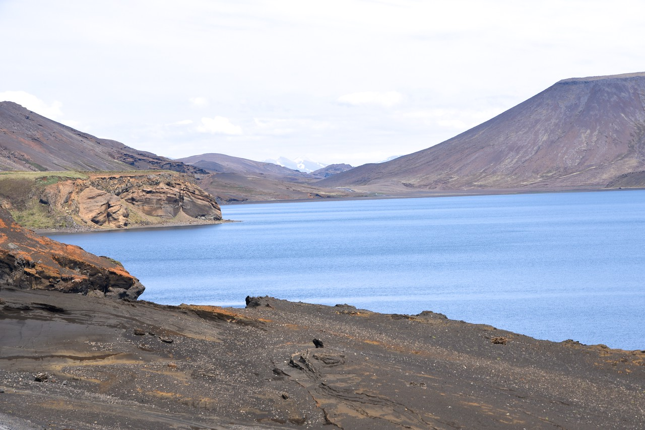 Fresh Water Lake Surrounded By Lava Rock Mountains