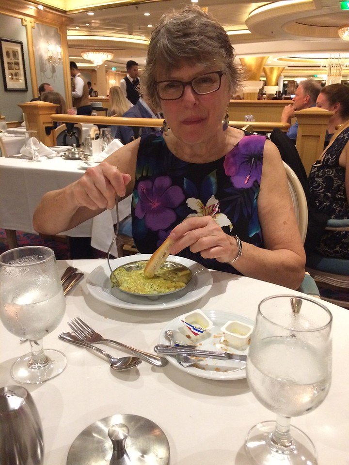 Janet enjoying her oysters and cheesy sauce