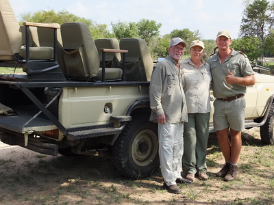 After an overni.ght In Johannesburg, we flew to Hoedspruit and went on a safari at Kapama River Lodge.  Saw lots of game.  This is photo of us with our ranger, IP.