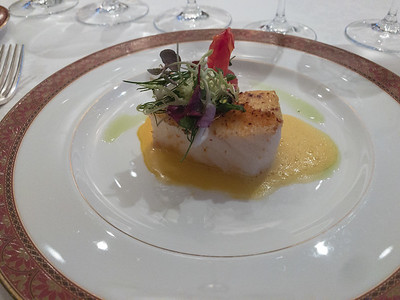 Sun Dried tomato crusted Chilean Seabass, fine herb salad and saffron buerre blanc
