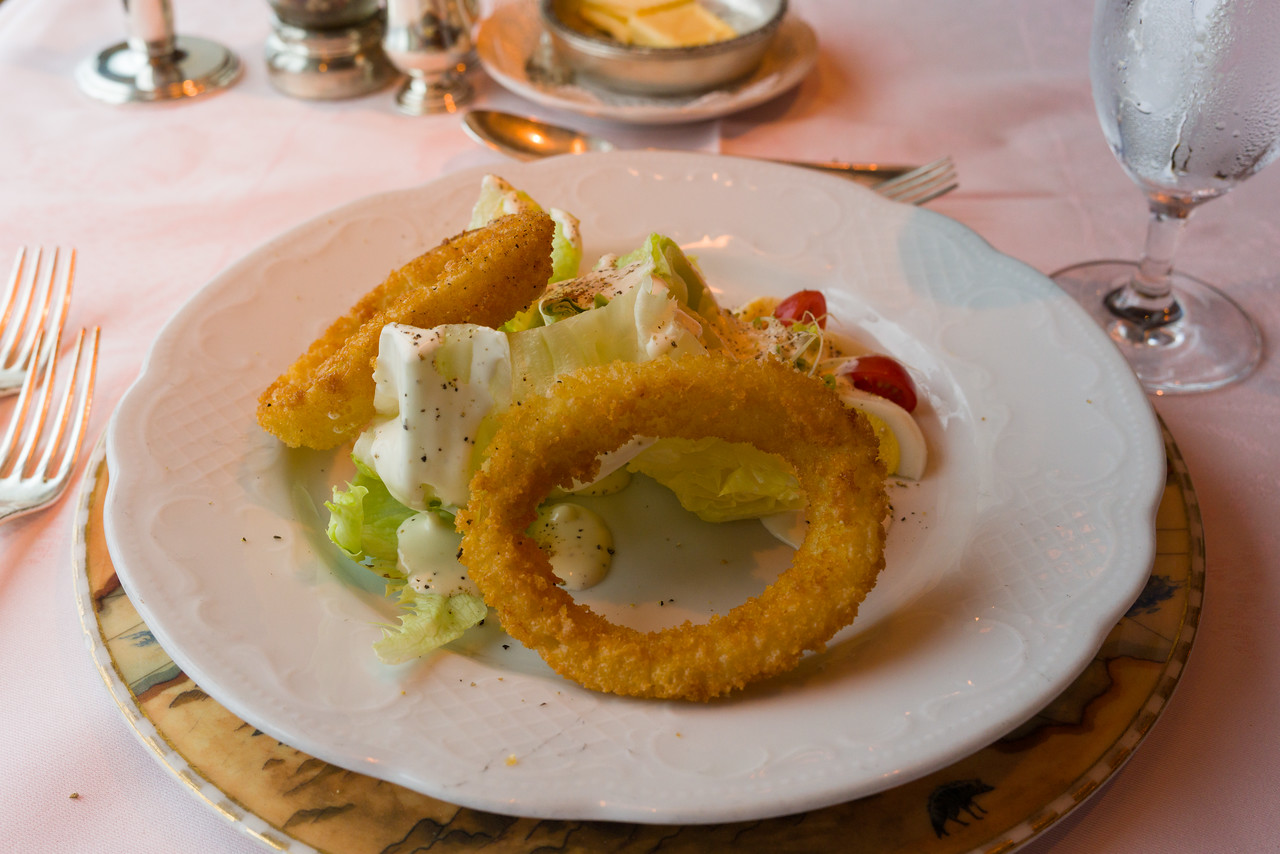 A little lettuce, some ginormous onion rings and dressing, I guess thats a salad