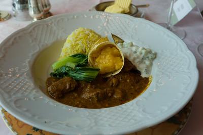 West Indies lamb curry, Biryani, baby bok choy, eggplant, pappadums & Mango chutney