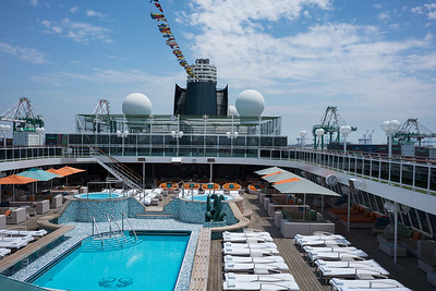 Pool and hot tubs on the Lido deck from the bow facing aft.