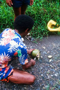 Felix, from Vanavatu, opening up a coconut for a cool refreshing drink.  Felix was engaged to Moe's daughter and in exchange for room and board, was building Moe a boat.