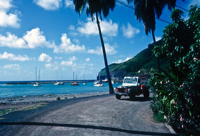 The main (only) road on the island.  Yachts, from around the world, anchored in Haka Hau.