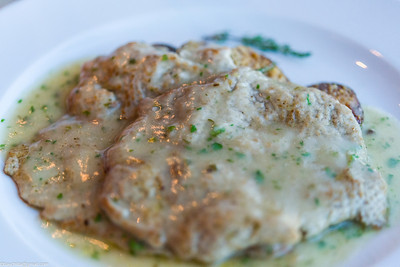 Veal in a buttery lemon sauce