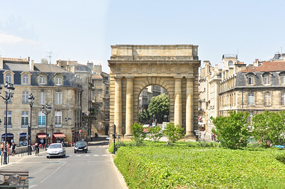 An arch leading into the downtown part of Bordeaux.